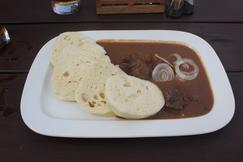Plate of Czech goulash with dumplings.