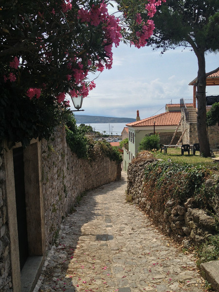Cobblestone street overlooking the Adriatic Sea.