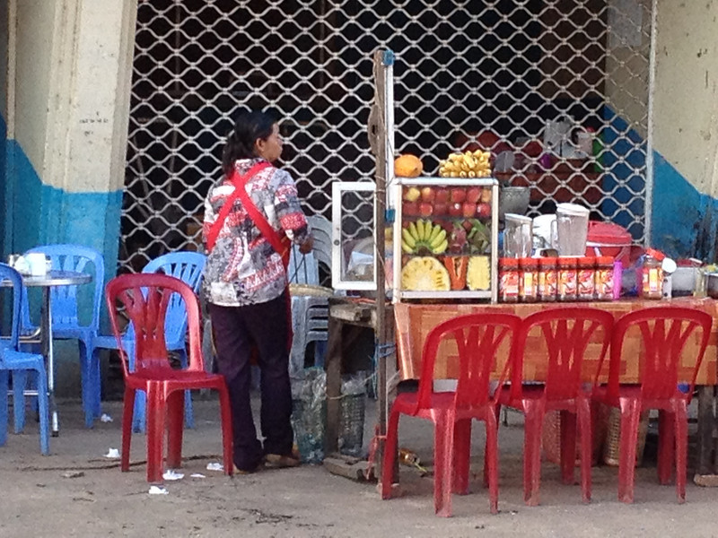 Woman selling fruit shakes in Kampot, Cambodia.