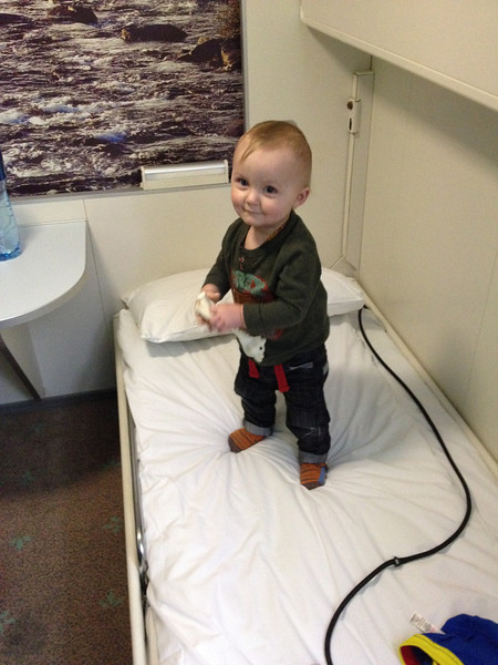 baby standing on bed