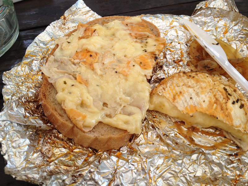 Hermelin cheese and onions on bread.