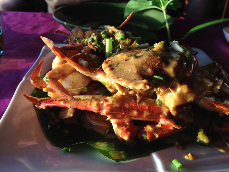 Plate of crab covered in spicy sauce.